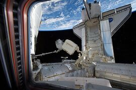 Space shuttle Endeavour is docked with the International Space Station as the space station's Canadarm2 transfers a load for installation on the ISS, on May 19, 2011. THE CANADIAN PRESS/AP, NASA