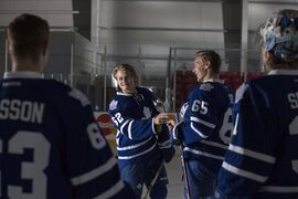 Toronto Maple Leafs William Nylander, centre left, shares a joke with Viktor Loov (65) during training camp in Toronto on September 18, 2014. It may take time for the Toronto Maple Leafs prospect William Nylander to get used to North America's physical style of hockey. It's a different story off the ice, where Nylander's roommate is making sure he enjoys some of the comforts of his native Sweden. THE CANADIAN PRESS/Chris Young
