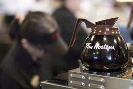 Freshly-brewed coffee sits on a hot plate in a Tim Hortons outlet in Oakville, Ont. on Sept.16, 2013. Tim Hortons says about 350 employees lost their jobs this week in layoffs across its organization, focused mainly at its headquarters and regional offices. THE CANADIAN PRESS/Chris Young