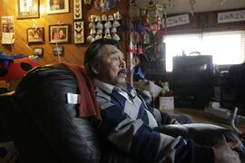 Veteran hunter Frank Pokiak talks during an interview at his home in Tuktoyaktuk, Northwest Territories, Aug.9, 2009. Pokiak remembers long days on the land, camped at traditional hunting grounds under June's 24-hour sun, secure in the knowledge that sea ice would provide a safe highway back to his Tuktoyaktuk home. Those days are gone. THE CANADIAN PRESS/AP /Rick Bowmer