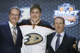 Nick Ritchie stands with Anaheim Ducks officials at NHL draft, on June 27, 2014, in Philadelphia. THE CANADIAN PRESS/AP, Matt Slocum