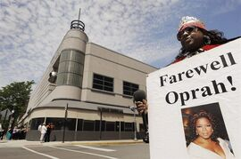 FILE - In this May 24, 2011 file photo, Kimberly Adams holds a poster outside Harpo Studios before the final taping of