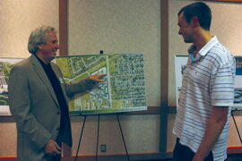 City of Winnipeg manager of urban design John Kiernan shows some plans to East Kildonan resident Jordan Skowronek at an open house at Canad Inns Transcona on May 16.