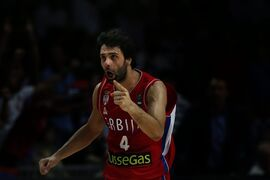 Serbia's Milos Teodosic celebrates at the end of the Basketball World Cup semifinal between Serbia and France in Madrid, Spain, Friday, Sept. 12, 2014. The 2014 Basketball World Cup competition will take place in various cities in Spain from Aug. 30 through to Sept. 14. Serbia won 90-85 and will play the U.S.A. in the final on Sunday. (AP Photo/Daniel Ochoa de Olza)