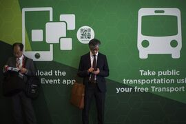 A visitor checks his smartphone during the Mobile World Congress, the world's largest mobile phone trade show in Barcelona, Spain, Monday, March 2, 2015. (AP Photo/Emilio Morenatti)