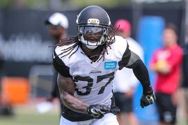 Jacksonville Jaguars safety Johnathan Cyprien (37) runs to the ball in a seven-on-seven drill during NFL football training camp in Jacksonville, Fla.,Wednesday, July 30, 2014. (AP Photo/Gary McCullough)