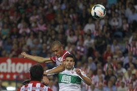 Atletico's Miranda, center, scores his goal during a Spanish La Liga soccer match between Atletico de Madrid and Elche at the Vicente Calderon stadium in Madrid, Spain, Friday, April 18, 2014. (AP Photo/Gabriel Pecot)