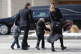 Family members and friends arrive at the Bergthaler Mennonite Church for the funeral of the four Froese brothers, Bobby, 15, Timmy, 12, Danny, 11, and Henry, 9, in Winkler, Man., Wednesday, March 4, 2015. The brothers were killed in a house fire in Kane, Man. on February 25. THE CANADIAN PRESS/John Woods