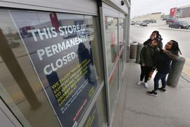 Future Shop customers are turned away by closed signs at a store in Winnipeg, Saturday, March 28, 2015. The recent closures of Future Shop and Target stores highlight a conundrum that's got urban planners and real estate experts talking. THE CANADIAN PRESS/John Woods