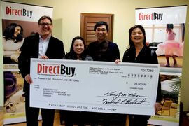 (From left) DirectBuy of Winnipeg owner Dwight Till, Renee Yap, Jonachiu Yap and DirectBuy of Winnipeg owner Lynn Till. Jonachiu Yap won DirectBuy's annual $25,000 Home Makeover contest.