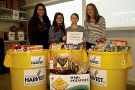 Henry G. Izatt students Brooke Munsters (far left) and Maegan Howard (far right) and Springfield Heights students Lauren Boyko (middle left) and Paige Gray (middle right) attended the Operation Donation weigh-in event at Winnipeg Harvest.