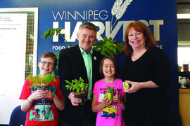 Windsor School students Tommy Bennet and Cara Spurrill with CWF horticulture education manager Ken Beattie and Winnipeg Harvest director of development Kate Brenner.