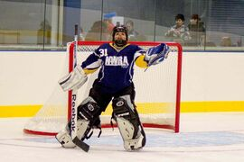 Thirteen-year-old Garden City Aces goalie Sara Pacheco keeps her eye on the ring.