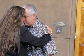 Mike McCartney, center, Gov. David Ige's chief of staff, greets Mauna Kea telescope opponent Kealoha Pisciotta, using honi, a traditional Hawaiian forehead-to-forehead greeting. Pisciotta and other telescope opponents delivered petition signatures against the project to the governor's office at the Hawaii Capitol in Honolulu on Monday, April 20, 2015. (AP Photo/Jennifer Sinco Kelleher)