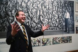 "Sean O'Harrow, director of the University of Iowa Museum of Art comments on the conservation treatment of his museum's Jackson Pollock's ""Mural,"" 1943, during a media preview at the J. Paul Getty Museum in Los Angeles on Monday, March 10, 2014. The oil-on-canvas work, measuring more than 8 feet high and nearly 20 feet long, has been under wraps at the J. Paul Getty Museum for more than a year undergoing extensive restoration. The painting will be on display at The J. Paul Getty Museum for three months, from March 11 to June 1, 2014 at the Getty Center. (AP Photo/Nick Ut )"