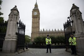 British police officers stand guard outside the Houses of Parliament in London, Monday, Sept. 1, 2014. Britain's Prime Minister David Cameron is expected on Monday to expand powers to combat terrorism in hopes of preventing attacks by Islamist militants returning from terror training in the Middle East. (AP Photo/Matt Dunham)