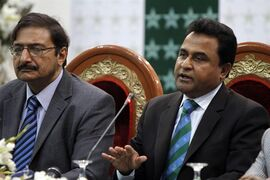 FILE - This is a Sunday, March 4, 2012 file photo of Bangladesh Cricket Board President Mustafa Kamal, right, as he speaks as Pakistan's Cricket Board Chairman Zaka Ashraf, looks on during a press conference in Lahore, Pakistan. Mustafa Kamal resigned as ICC president on Wednesday April 1, 20015, accusing India of influencing the outcome of the Cricket World Cup quarterfinal against Bangladesh. (AP Photo/K.M. Chaudary, File)
