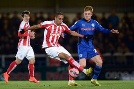 Stoke City's Steven N'Zonzi and Rochdale's Callum Camps, right, in action during their English FA Cup Fourth Round match at Spotland Stadium, in Rochdale, England, Monday Jan. 26, 2015. (AP Photo / Martin Rickett, PA) UNITED KINGDOM OUT - NO SALES - NO ARCHIVES