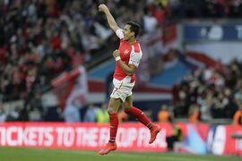 Arsenal's Alexis Sanchez celebrates after scoring a goal during the English FA Cup semifinal soccer match between Arsenal and Reading at Wembley Stadium in London, Saturday, April 18, 2015. (AP Photo/Tim Ireland)