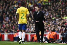 Brazil's head coach Dunga, right, talks to Brazil's Danilo, left, during the international friendly soccer match between Brazil and Chile, at the Emirates stadium, in London, Sunday, March 29, 2015. (AP Photo/Tim Ireland)