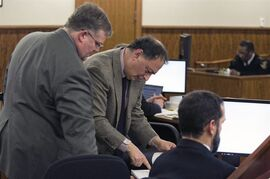 Defense attorney James Sultan reviews a document with prosecutor Roger L. Michel during the murder trial of former New England Patriots football player Aaron Hernandez at Bristol County Superior Court Tuesday, March 3, 2015, in Fall River, Mass. Hernandez is accused of the June 2013 killing of Odin Lloyd. (AP Photo/Dominick Reuter, Pool)