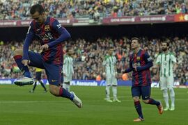 FC Barcelona's Pedro Rodriguez, jumps after scoring against Cordoba during a Spanish La Liga soccer match at the Camp Nou stadium in Barcelona, Spain, Saturday, Dec. 20, 2014. (AP Photo/Manu Fernandez)
