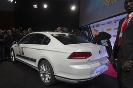 The New Volkswagen Passat, the car of the Year 2015, is on display during the award ceremony ahead of the Geneva Motor Show in Geneva, Switzerland, Monday, March 2, 2015. The large family car Volkswagen Passat has been voted car of the year by European automotive editors at the Geneva International Motor Show. German Volkswagen's four-door sedan beat six other finalists including Citroen's C4 Cactus, Renault's Twingo and the BMW 2-Series Active Tourer. The Passat has an updated collision avoidance system compared to its predecessor and other new technology, including emergency driver assistance and cross-wind stabilization. (AP Photo/Keystone,Sandro Campardo)
