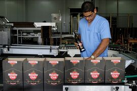 In this Oct. 22, 2010, file photo, a worker checks the production of Havana Club rum at the company's factory in Havana, Cuba. U.S. rum aficionados are abuzz over the potential for making Cuba Libres with Cuban rum, now that Americans visiting the Caribbean island will be allowed to bring home rum distilled there for the first time since the embargo took effect 55 years ago. Meanwhile, industry titan Bacardi, which was driven from the island by the 1959 Castro revolution, says it's waiting to see what the impacts of thawing U.S.-Cuba relations will be. (AP Photo/Franklin Reyes, File)