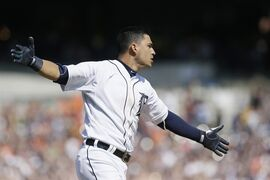 Detroit Tigers' Jose Iglesias celebrates as he runs to first base after driving in the winning run with an RBI single in the ninth inning of a baseball game against the Chicago White Sox, Friday, April 17, 2015, in Detroit. The Tigers defeated the White Sox 2-1. (AP Photo/Carlos Osorio)