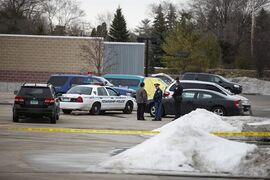 Police gather together in the parking lot of Saginaw Township Wal-Mart, Tuesday, March 11, 2014. Police found a 1995 GMC Sierra that matches the description of Terry Trafford's vehicle. Police found a body in the truck but have not yet identified the person. (AP Photo/The Saginaw News, Neil Barris)