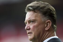 Manchester United's manager Louis van Gaal stands on the touchline before his team's English Premier League soccer match against Queens Park Rangers at Old Trafford Stadium, Manchester, England, Sunday Sept. 14, 2014. (AP Photo/Jon Super)
