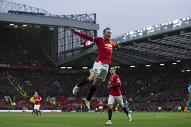 Manchester United's Wayne Rooney, center, celebrates after scoring his second goal during the English Premier League soccer match between Manchester United and Sunderland at Old Trafford Stadium, Manchester, England, Saturday Feb. 28, 2015. (AP Photo/Jon Super)
