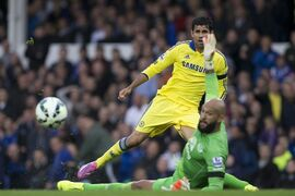 Chelsea's Diego Costa, top, is thwarted by Everton's goalkeeper Tim Howard during their English Premier League soccer match at Goodison Park Stadium, Liverpool, England, Saturday Aug. 30, 2014. (AP Photo/Jon Super)