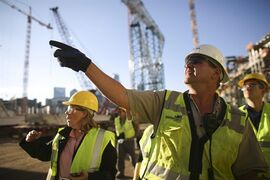 In this photo taken on Oct. 20, 2014, Dave Mansell, ceneral superintendent of the Vikings stadium for M.A. Mortenson Co., leads a tour of the Vikings new NFL football in Minneapolis. The Vikings say ticket sales for the new stadium are moving at a brisk pace. (AP Photo/The Star Tribune, Jeff Wheeler) MANDATORY CREDIT; ST. PAUL PIONEER PRESS OUT; MAGS OUT; TWIN CITIES LOCAL TELEVISION OUT