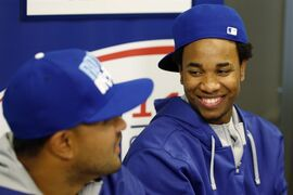 Kansas City Royals' Yordano Ventura, right, smiles as Christian Colon talks during a media availability, Monday, Oct. 20, 2014, in Kansas City, Mo. The Royals are scheduled to play Game 1 of baseball's World Series against the San Francisco Giants on Tuesday. (AP Photo/Orlin Wagner)