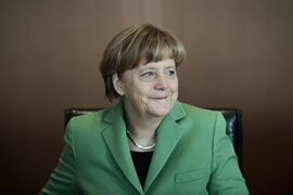 German Chancellor Angela Merkel smiles at the beginning of the weekly cabinet meeting of her government at the chancellery in Berlin, Wednesday, Jan. 28, 2015. (AP Photo/Markus Schreiber)