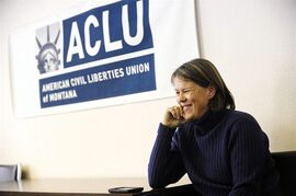 Sue Hawthorne smiles during a news conference announcing the ruling by U.S. District Court Judge Brian Morris calling Montana's gay marriage ban unconstitutional, Wednesday, Nov. 19, 2014 in Helena, Mont. Hawthorne and her partner Adel Johnson are plaintiffs in the case and were married earlier this year in Washington state. (AP Photo/The Independent Record, Thom Bridge)