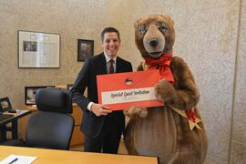 Mayor Brian Bowman receives an invitation from Filbert the Bear to take to the stage during the Dec. 28 matinee performance of RWB's Nutcracker.