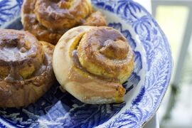 This Sept. 8, 2014 photo shows salted caramel pumpkin buns in Concord, N.H. The bun combines two classics, pumpkin pie and a cinnamon bun, which is topped with a homemade caramel sauce. (AP Photo/Matthew Mead)