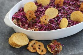 This Jan. 26, 2015 photo shows the Seattle super seven dip, made with teriyaki-seasoned Dungeness crabmeat, creamy cheese, caramelized onions, smoked mussels, purple cabbage slaw and blackberry vinaigrette, in Concord, N.H. (AP Photo/Matthew Mead)