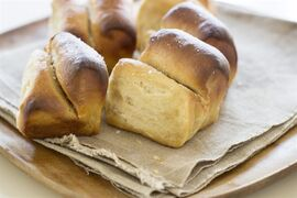 This Oct. 6, 2014, photo shows cider house butter rolls in Concord, N.H. These easy-to-make dinner rolls are inspired by buttery parkerhouse rolls, but are spiced and sweetened with a bit of fresh apple cider that has been boiled down to a syrup. (AP Photo/Matthew Mead)