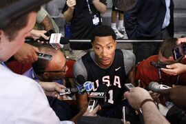 USA Basketball player Derrick Rose is interviewed at the end of an USA Basketball training camp practice at Mendenhall Center in Las Vegas Monday, July 28, 2014. (AP Photo/Las Vegas Review-Journal, Erik Verduzco) LOCAL TELEVISION OUT; LOCAL INTERNET OUT; LAS VEGAS SUN OUT