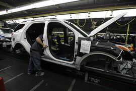 FILE - In this Dec. 1, 2010 file photo, plant employees assemble a 2011 Ford Explorer on the assembly line at Ford's Chicago Assembly Plant. Ford Motor Co. said Wednesday, May 22, 2013 that 21 of its North American factories will shut for only one week this summer. That includes the Chicago plant that makes the Ford Explorer SUV and the Mexican plant that makes the Fusion sedan. (AP Photo/M. Spencer Green, File)