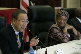 In this photo released by the United Nations, U.N. Secretary-General Ban Ki-moon, left, meets with Liberia's President Ellen Johnson Sirleaf, at the Ministry of Foreign Affairs, in Monrovia, Liberia, on Friday, Dec. 19, 2014. Ban praised health workers battling Ebola in Sierra Leone and Liberia on Friday, saying they have shown