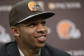 FILE - In this May 9, 2014, file photo, Cleveland Browns cornerback Justin Gilbert smiles during his introductory news conference at the NFL football team's facility in Berea, Ohio. The Browns have signed rookie Gilbert, one of their first-round draft picks, to a four-year, $12.8 million contract. (AP Photo/Tony Dejak, File)