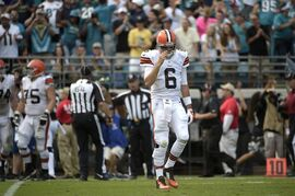 Cleveland Browns quarterback Brian Hoyer (6) walks off the field after throwing an interception to Jacksonville Jaguars outside linebacker Telvin Smith during the second half of an NFL football game in Jacksonville, Fla., Sunday, Oct. 19, 2014. Browns coach Mike Pettine has no plans to bench Hoyer for rookie Johnny Manziel following Sunday's ugly loss at Jacksonville.(AP Photo/Phelan M. Ebenhack)