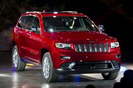 FILE - In this Jan. 14, 2013 file photo, the 2014 Jeep Grand Cherokee is introduced at the North American International Auto Show in Detroit. Chrysler is recalling 184,215 SUVs worldwide because a wiring problem could disable their air bags and seat belt pretensioners. The recall involves the 2014 model year Dodge Durango and Jeep Grand Cherokee. (AP Photo/Tony Ding, File)