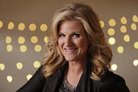 FILE - In this Aug. 18, 2014 file photo, Trisha Yearwood poses in Nashville, Tenn. Yearwood and Carlos Santana are among the musicians set to perform the national anthem during the World Series. Major League Baseball said Monday, Oct. 20, that Yearwood will sing