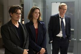 This image released by Warner Bros. Pictures shows Johnny Depp, from left, Rebecca Hall and Paul Bettany in a scene from