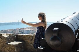 This June 2013 photo shows Abigail Austin taking a selfie on a trip to Lisbon, Portugal, when she was 17. Young travelers say they enjoy taking selfies to preserve and curate travel memories while sharing experiences with friends. But some older travelers worry that spending too much time on social media can be a distraction from enjoying and learning about a place. (AP Photo/Susan Austin Photography)